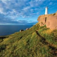 The East Coast Trail skirts the cliffs at Cape Spear Lighthouse   Barrett & MacKay Photo