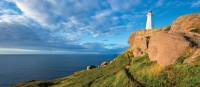 The East Coast Trail skirts the cliffs at Cape Spear Lighthouse | Barrett & MacKay Photo