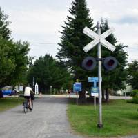 Cycling through the charming village of Val David | Nathalie Gauthier
