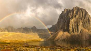 A colourful rainbow near Talus Lake in the Yukon | Robert Postma Photography