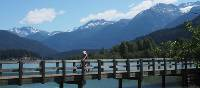Cycling over Green Lake in Whistler Valley | Tourism Whistler/Feet Banks
